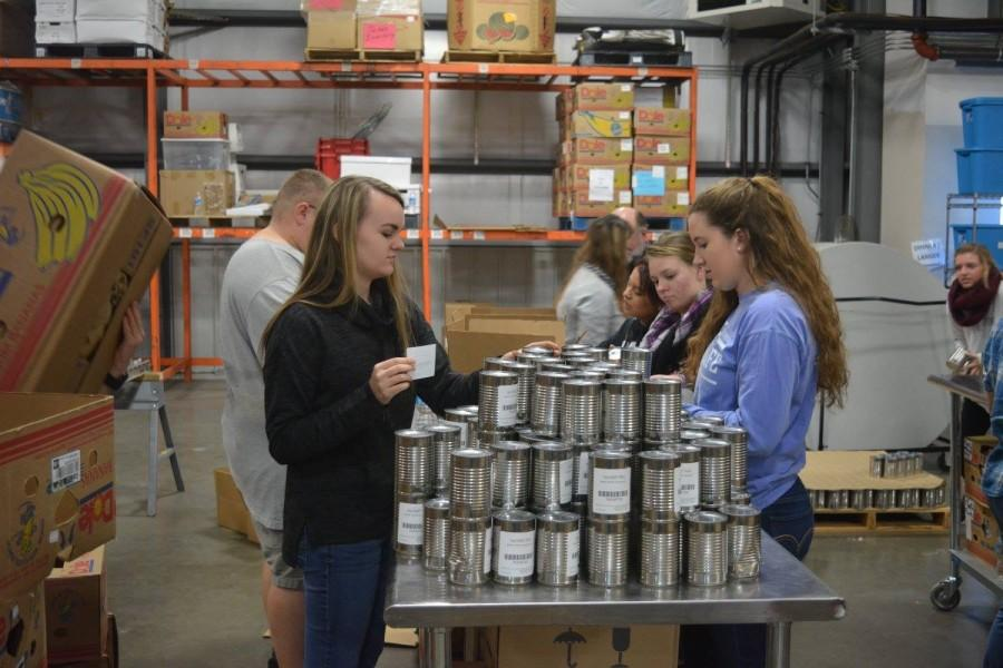 STUDENTS LEND A HELPING HAND -- The CHS National Honors Society bonds by volunteering at the Chattanooga Area Food Bank.