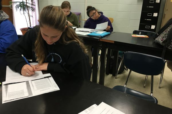 FORENSICS FUN -- Senior Katy Pollock enjoys reading the case studies Mrs. Cotreau assigns in class.