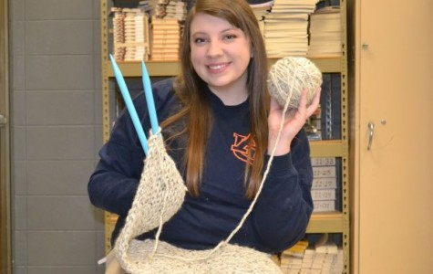 YARN AND  KNITTING PINS -- Emma Beach poses ready to knit with her yarn and pins.