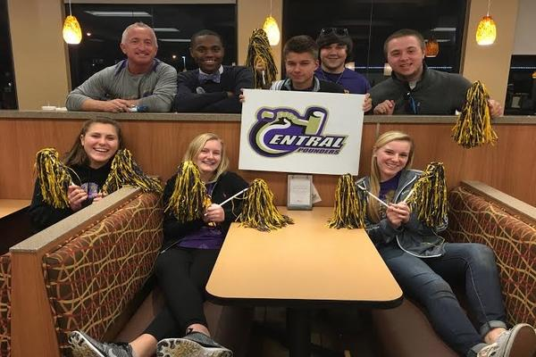 CHICK-FIL-A HAS POUNDER PRIDE -- Central Students and Mr. King attend the Track Team's Spirit Night at Chick-fil-a.