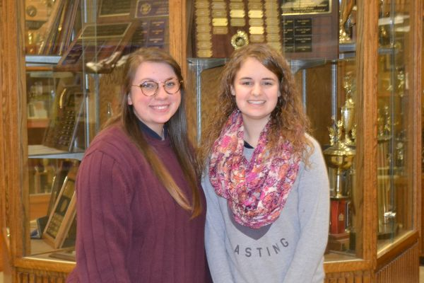 VALEDICTORIAN AND SALUTATORIAN -- Emma Beach (left), salutatorian, and Jadyn Snakenberg (right), valedictorian,  happily stand together as the top of their class.