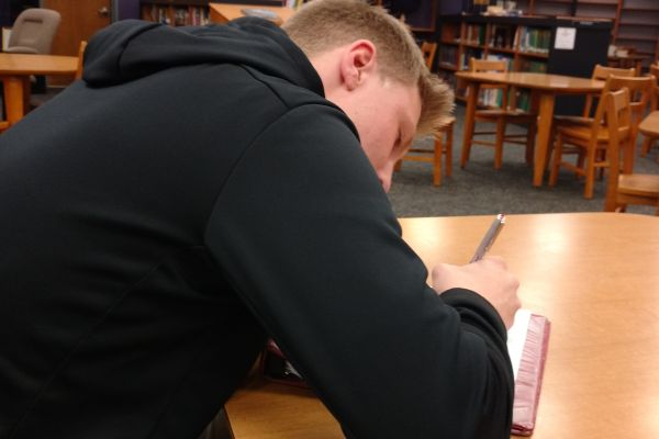 STUDENTS GET INTO THE GROOVE OF WRITING FOR BLACK HISTORY MONTH -- Junior Taylor Hamby gets his creative juices flowing.