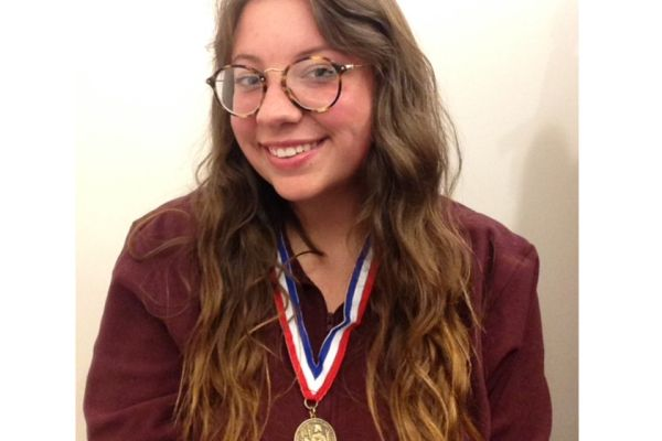 SENIOR EMMA BEACH RECEIVES GEORGE WASHINGTON MEDAL OF HONOR -- Salutatorian Emma Beach receives a medal of honor due to her hard work and outstanding writing abillities.