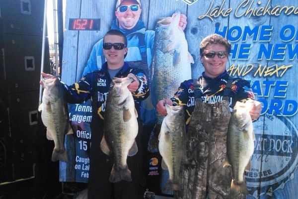 GAVIN AINSLIE AND AJ BARNES SHOW THEIR BEST CATCHES -- AJ Barnes, who received a full-ride scholarship for fishing,  stands beside Gavin Ainslie to show their best catches in the tournament.