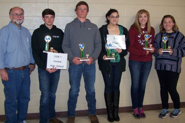CENTRAL'S ENVIROTHON TEAM GETS AWARDED THIRD PLACE -- (Left to right) Coach Dillard Evans, Doug Bell, Tucker Smith, Shasta Faile, Shelby Campbell, and Hannah Stone smile for the camera with their third place trophies.