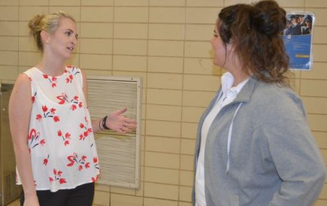 NEW SCHEDULING -- Mrs. Lindsey Ruggles (left) explains the scheduling procedures for next year to upcoming senior Rachel Woodward.