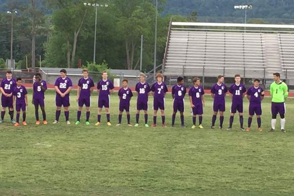 BOYS' SOCCER LINES UP FOR ONE OF THEIR FINAL GAMES-- The boys' soccer team lines up and gets their names called for one of their final games of the season.