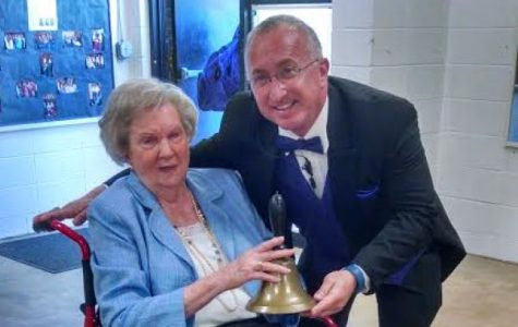 CENTRAL BELL RINGING IN MEMORIES-- Ogle donates famous bell from old Central to Mr. King at Senior Day this year