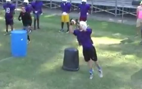 FOOTBALL CONDITIONING BEGINS -- Evan McDaniel, an upcoming sophomore, catches the ball during a drill.