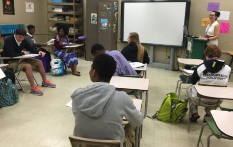 TEACHER LECTURES CLASS -- Mrs. White is teaching her students about creatively writing stories, plays, etc.