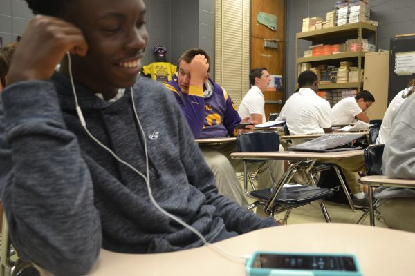 MUSIC LOVE -- Sophomore Deshun Coonrod listens to some of his favorite music from this summer.