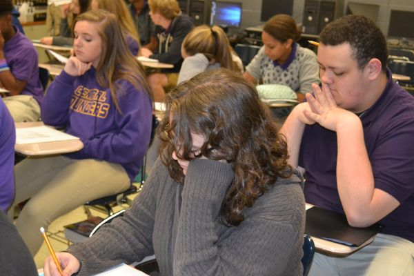 FRESHMEN HARD AT WORK -- These freshman, including (left to right) Lauren Green, Samantha Helmholtz, and James Ortiz, are very focused as they adjust into their honors English class at Central High.