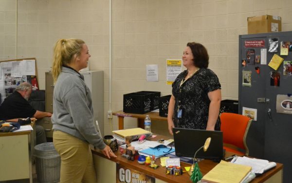 STUDENT CONSULTS WITH MS. HOOPER -- Emily Feist talks with Ms. Danielle Hooper, Central's new gifted teacher, about daily life here at school.