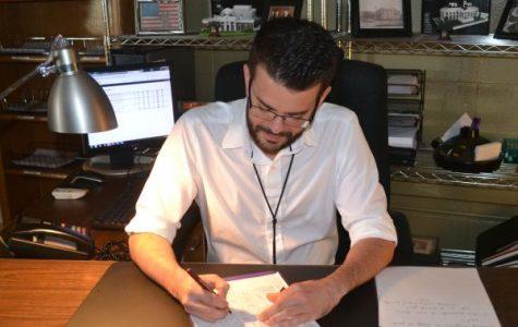 A TEACHER'S JOB -- Mr. Seals is shown grading an assignment.