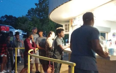 POUNDER FAMILY REPLENISHING AT HOME FOOTBALL GAME -- Central football fans and supporters line up at the concession stand for a quick grab.