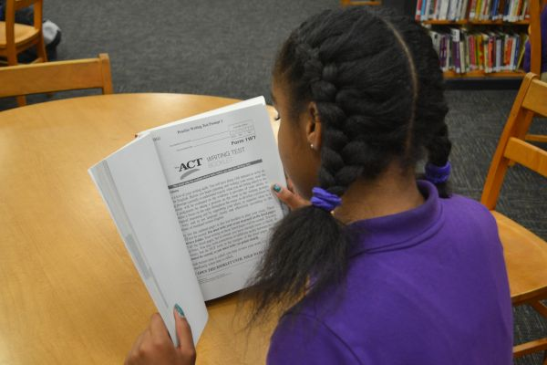 STUDENT PREPARING FOR THE ACT-- A student studies diligently for the upcoming ACT test in the library.