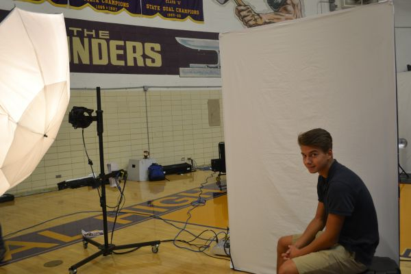 SMILE FOR THE PICTURE -- Students get all nice and pretty for their perfect shot in the yearbook.