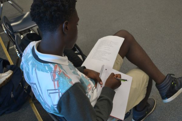 ACTING STUDENTS LEARN TO WRITE SCRIPTS -- Deshun Coonrod, one of Mrs. White's acting students, works to optimize his script writing skills.