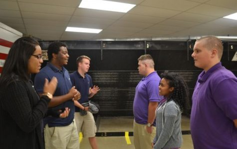 SURVIVING HIGH SCHOOL TOGETHER-- Seniors (left to right) Alyssa Barclay, Reubin Thrasher, and Thomas Hutto give advice to freshmen (left to right) Donovan Walker, Bileah Sit, and Leonard Hussey.