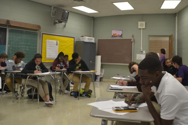 SOME STUDENTS SUFFER FROM A MATH PHOBIA -- Algebra I students in Ms. Brazeale's class strive to soar in math.