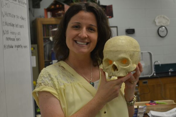 CHRISTINA COTREAU SHOWS OFF HER LOVE FOR BIOLOGY -- Mrs. Cotreau holds on tight to her fake skull while she teaches students about the human body.