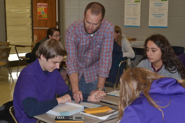 MR. JEFFERY MULLINS HELPS STUDENTS UNDERSTAND THEIR ALGEBRA I ASSIGNMENT-- One of Central's Algebra I teachers, Mr. Mullins, helps students with their work after teaching a lesson.