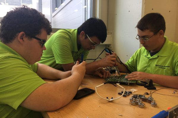THIRTY-SIX STUDENTS APPLIED FOR UPCOMING YEAR AT THE VOLKSWAGEN MECHATRONICS AKADEMIE -- Last fall's Mechatronics Akademie students learning in the Volkswagen Academy building's classroom.