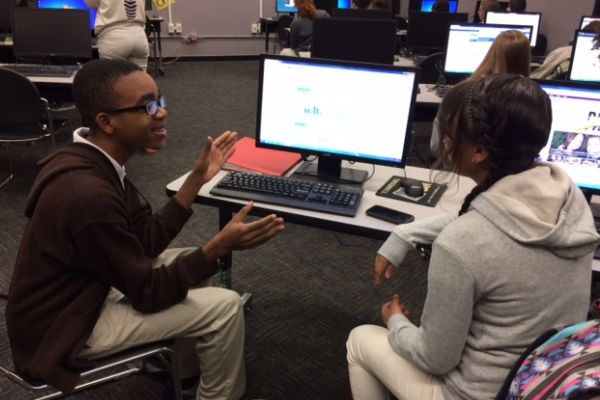 THE CENTRAL STOCK MARKET TEAM -- Tenth grade, stock market team members, Christian Thomas and Edicklee Frias-Cruz converse about the rising and falling stocks of certain corporations.