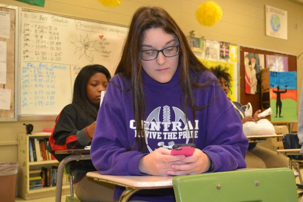 SMARTPHONES ARE CONSTANTLY HOGGING STUDENTS ATTENTION-- Sophomore student of Central High School, Caitlin Leamon, uses her smartphone during school.