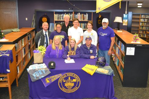 HEADED TO TECH -- Brooke Parrot signs to play for Tennessee Tech while her friends, family, teachers, and coaches stand by her.