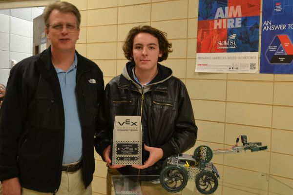 THE CENTRAL ROBOTICS TEAM WINS THIRD PLACE IN THE STATE QUALIFIERS-- (From left to right) Mr. Keith Bright and a member of the winning team, Edward Rhymer, hold the third place trophy from VEX, next to the award winning robot.