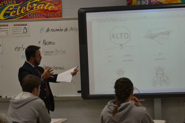 CENTRAL SPANISH TEACHER MR. JOSE SANCHEZ INSTRUCTS HIS SPANISH II CLASS--Mr. Sanchez explains to students ways to remember Spanish vocabulary words by correlating the words with English words.