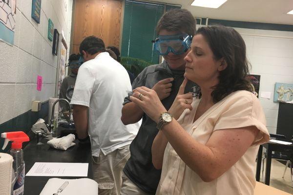 GRANT MONEY OFFERS NEW LAB EXPERIENCE FOR STUDENTS -- Tina Cotreau experiments in the lab with forensic science student Walker Waters.
