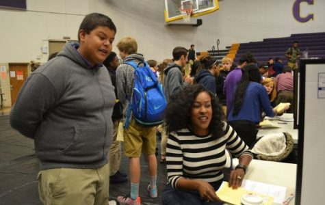 FRESHMEN STUDENTS GET A REALITY CHECK -- Central High freshmen check-in with various life scenarios to get a