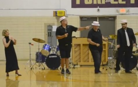 CENTRAL HIGH ANNUAL TEACHER TALENT SHOW -- (Left to Right) Janice Munson, Chris Kribs, Mickey Robinson, and Phillip Johnson preform an epic lip sync.