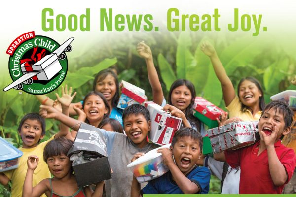 OPERATION CHRISTMAS CHILD --  Children celebrate happily as they receive their gifts from the organization
