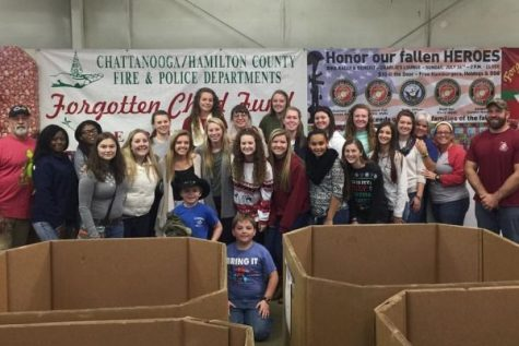 Central's Softball Team Packs Boxes For Forgotten Child Fund