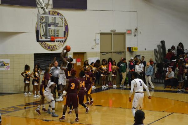 POUNDERS SHOOT FOR 2 -- The Central Boys Basketball Team goes up for 2 points against the Tyner Rams on November 22nd.