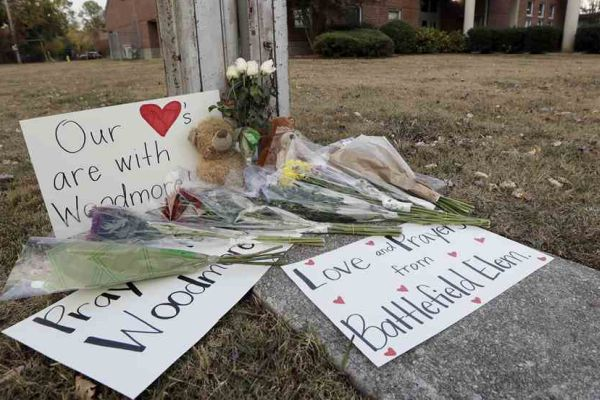 CENTRAL ALUMNI GIVE BACK AFTER WOODMORE TRAGEDY -- A memorial is placed near Woodmore Elementary adorned with flowers and signs with hopeful messages.