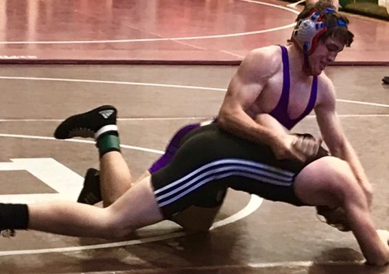 HARD WORK CONTINUES TO PAY OFF FOR WRESTLER ISAAC COFFEMAN--  Isaac Coffman pins down his opponent in a wrestling match