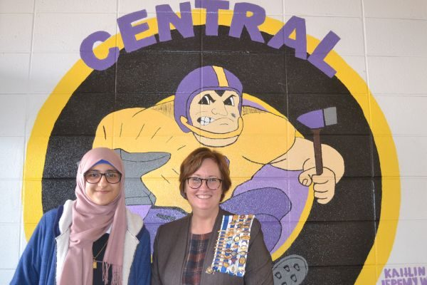 CENTRAL STUDENT ZEENA WHAYEB WINS LOCAL CHAPTER OF DAR ESSAY CONTEST -- Central sophomore student, Zeena Whayeb (left) stands with Teresa Rimer (right), the Daughters of the American Revolution  School Liason, in front of a Central mural.