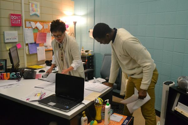 CENTRAL HIGH SENIORS EAGER TO RECEIVE ONE OF SEVERAL ALUMNI ASSOCIATION SCHOLARSHIPS  -- Central's college access adviser, Susan Dyer, and senior D'Andre Anderson discuss potential scholarship opportunities.