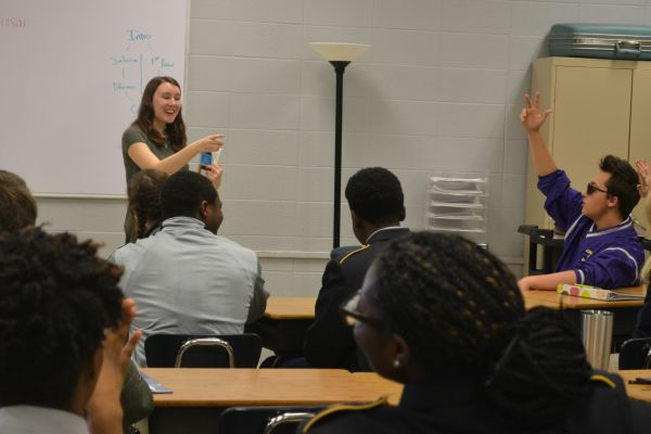 COLLEGE STUDENT TEACHERS LEARN HOW TO BE EDUCATORS -- Ms. Casey Hale, a UTC student-teacher, analyzes Shakespeare's play, Julius Caesar, with her Honors English 10 class.