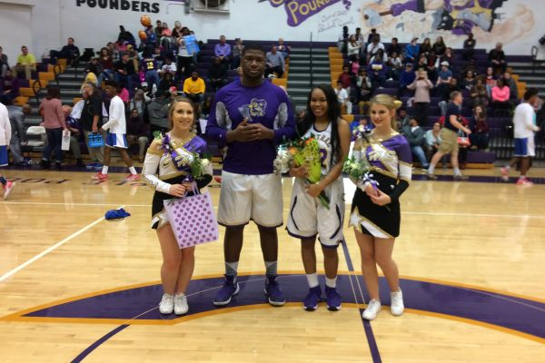 GIRLS AND BOYS BASKETBALL TEAM CELEBRATES SENIOR NIGHT AFTER BIG WIN -- Senior cheerleaders (from left to right) Vanessa Smith and Miranda Lillard celebrate their Senior Night with senior boys' basketball player McClendon Curtis and senior girls' basketball player Miracle Miller.