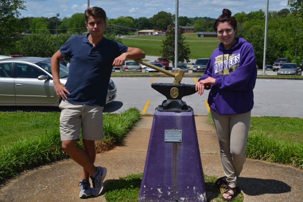 EDDY, HOLMBERG CHOSEN AS CLASS SPEAKERS OF 2017 -- Jared Eddy (left), the student representative, and Hannah Holmberg, the faculty representative, (right) pose next to the Central Hammer and Anvil.