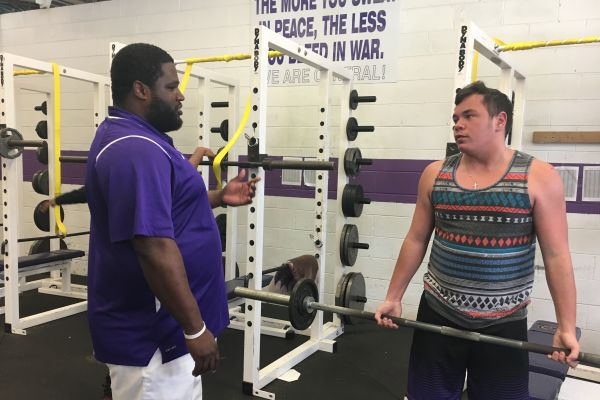 BRASWELL TO COACH TN-GA ALL-STAR FOOTBALL GAME-- Braswell(left) working with student athlete Jake Biddy (right) in the weight room.