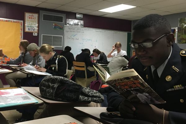CENTRAL STUDENTS HARD AT WORK -- Juniors are seen punching the day's newest assignment out of the ballpark.