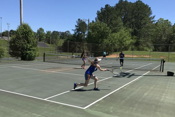 ANOTHER TENNIS SEASON WRAP UP -- The Central tennis team making due with a limited amount of courts and many players at practice.