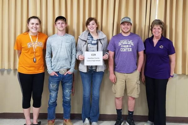 DONNA SELLERS SHARED 4TH PLACE WIN AT ENVIROTHON WITH STUDENTS -- Donna Sellers(far right), coach of Central's Envirothon team, celebrates a 4th place win with students (from left to right) Hannah Holmberg, Blake Williams, Shelby Campbell, and Elijah Garner.