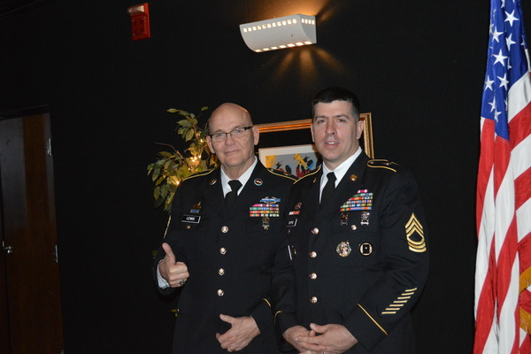 SERGEANT MAJOR LEWIS IS RETIRING AFTER 17 YEARS OF JROTC -- Sergeant Major Lewis stands beside Master Sergeant Dupre in full uniform.
